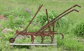 picture of horse plowing  - Vintage horse drawn spring tooth harrow display - JPG