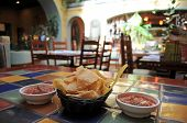 stock photo of mexican food  - Tortilla chips and salsa in a restaurant - JPG