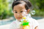 image of blowers  - Girl play with bubble blower at outdoor - JPG