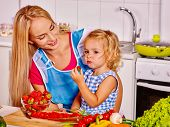 picture of child feeding  - Mother  feed happy child at kitchen  - JPG