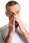 stock photo of sinuses  - Mature man suffering from sinus pressure pain - JPG