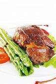 stock photo of white asparagus  - beef meat served on white plate with asparagus - JPG