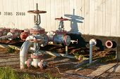 stock photo of pipeline  - Oil pipeline with a tap valve in the summer - JPG