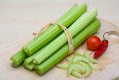 image of celery  - Fresh Green Celery sticks on the wood background - JPG