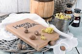 image of roughage  - Dried herb with nutmeg and book on table close up - JPG