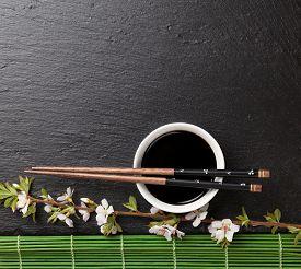 stock photo of black-cherry  - Japanese sushi chopsticks - JPG