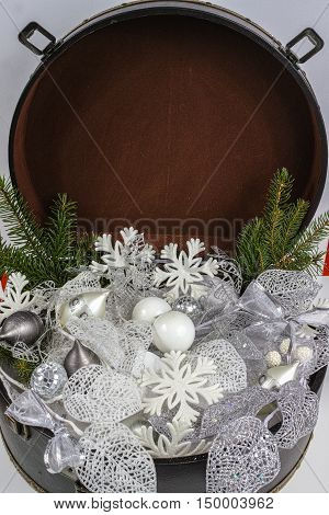 Vintage brown coffer with white Christmas tree decoration copy space