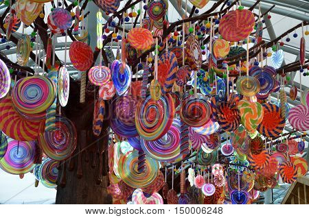 SINGAPORE - 02 OCT 2016: : Colorful candy model hanging on tree model in Resorts World Sentosa. This resort is the biggest resort on the Sentosa island featuring Universal studio