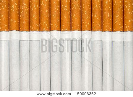 Cigarettes with filter as background. Abstract background