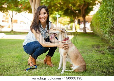 Pretty Girl With A Dog At The Park