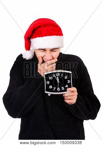 Tired Young Man in Santa Hat with the Clock On The White Background