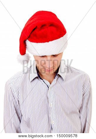 Sad Young Man Portrait in Santa's Hat Isolated On The White Background