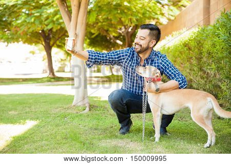 Young Man Taking Selfie With His Dog