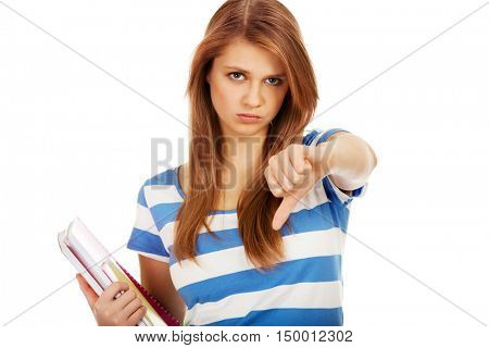 Teenage unhappy woman with thumbs down