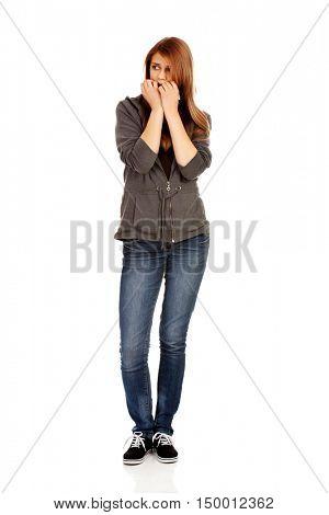 Stressed teenage woman biting nails