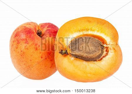 Whole and cut ripe fruits of apricot isolated on white background close up.