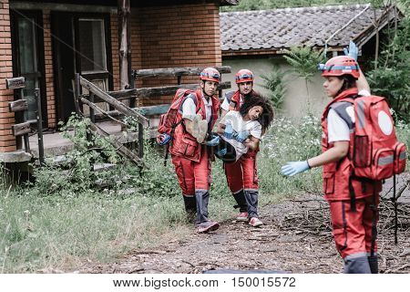 Victim evacuation from disaster struck area, toned image