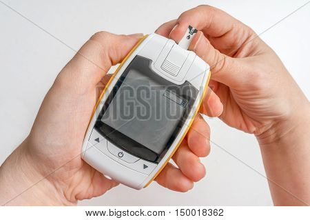 Diabetic Patient Is Using Glucometer For Measuring Blood Glucose