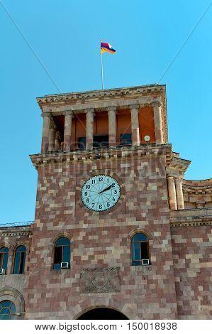 Yerevan. Armenia. Clock Tower and the national flag. vertical photo.
