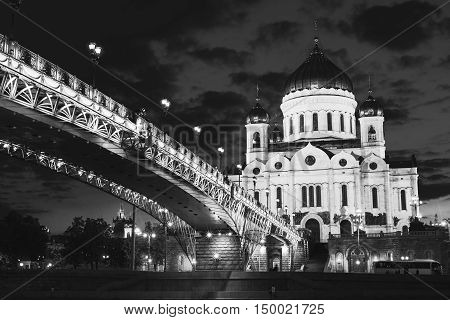 Beautiful illumination of Cathedral of Christ the Savior, Moscow, Russia and Patriarshiy Bridge at Night. Black and white