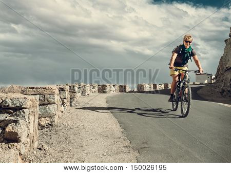 Bicycle tarveler rides on the road .