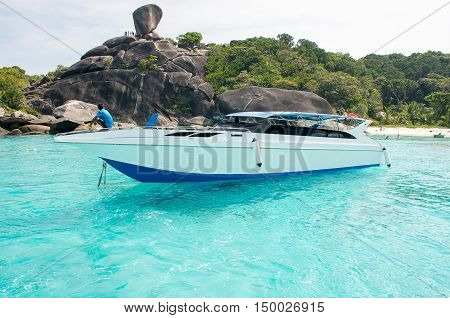 Gorgeous landscape of the sea coast tropical and high-speed boat at Similan island Focused at the boat