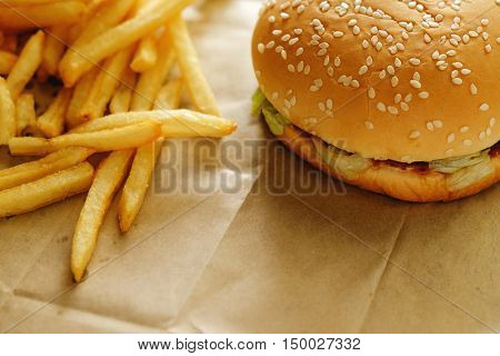 Cheese burger with beef patty on wooden table