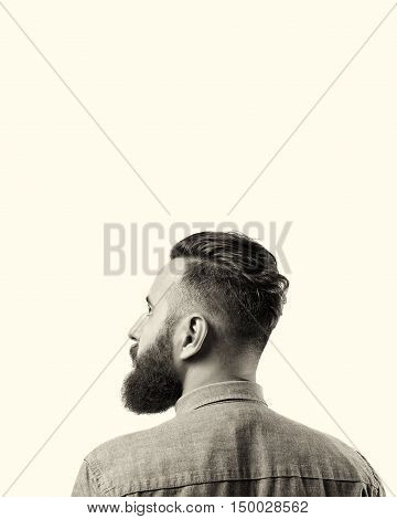 Black and white portrait of a bearded man in a denim shirt isolated on a white background. There is a spase for your text.