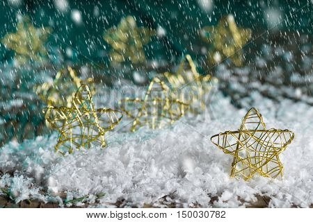 Christmas stars in the snow on the green background