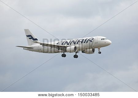 COPENHAGEN, DENMARK - MAY 13: Finnair A320 approaching Kastrup Airport, May 13th 2015. Finnair is Finland's flag-carrier airline.