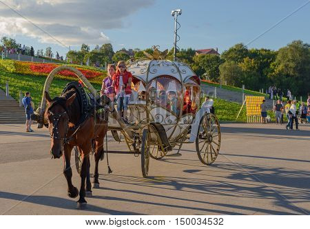 August 18 2013: Photo of horse-drawn carriage with a walk around the city. Cheboksary. Chuvashia. Russia.