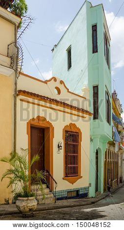 HAVANA, CUBA - JUNE 19, 2016: The homes on Angel Hill's Compostela street in the La Habana Vieja neighborhood have been painted in bright colors.