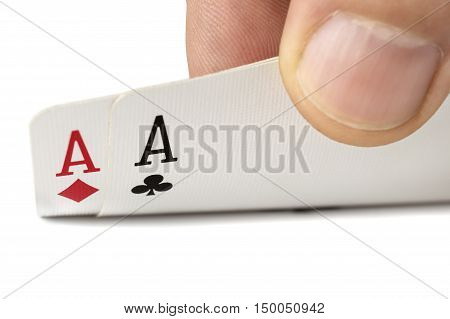 close up of man hand with pair of aces isolated over white
