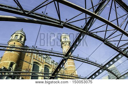 GENT (GHENT), BELGIUM - MAY 12, 2016: View looking up through a rain shelter at Gent-Sint-Pieter train station.  The shelter is constructed of see-through material held together with thin metal strips.