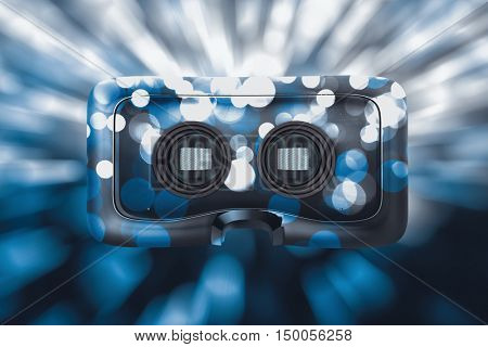 Close-up of virtual reality simulator against glowing background