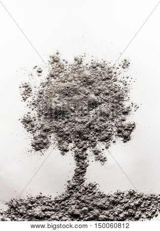 Tree relief shape made of grey pile of ash dust
