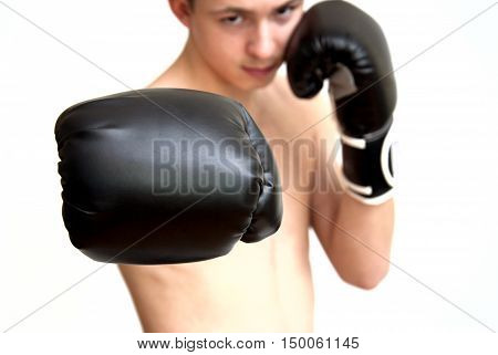 Teen boxer in black gloves on a white backgroun