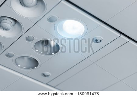 Modern passenger airplane cabin details passenger service unit panel light closed air conditioner attendant call buttons