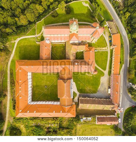 Aerial view of Benedictine monastery in Kladruby. Geometric pattern from baroque architecture. Landmarks from above. Czech Republic, Europe.