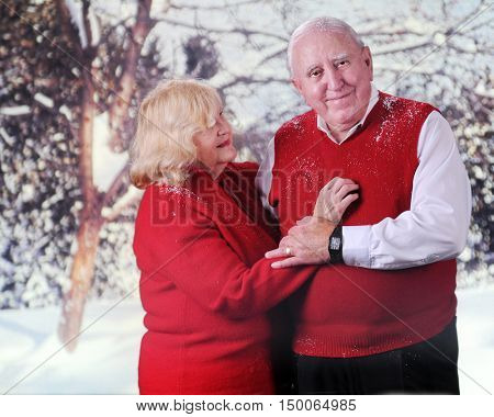 A loving senior couple enjoying the snow together.