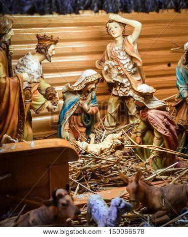 Christmas Manger scene with figurines including Jesus Mary Joseph sheep and magi