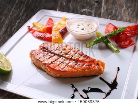 Grilled salmon steak and grilled vegetables.