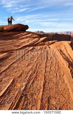 Couple hiking in Escalante national monument in Southwest USA