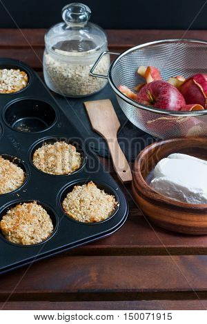 Muffins in the oven tray, oats, quark and apples