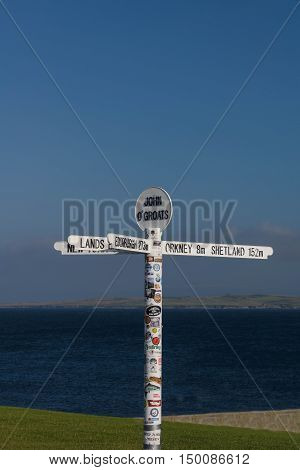 JOHN O GROATS, SCOTLAND--AUGUST 18, 2016--The popular signpost of John O Groats, a village in northern Scotland.  John O Groats is the destination point between the longest distance between two inhabited British points.