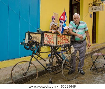 HAVANA - CUBA JUNE 9, 2016: Two dachshunds are dressed up by their owner to attract donations from passers-by of the Ambos Mundos Hotel to supplement his income.