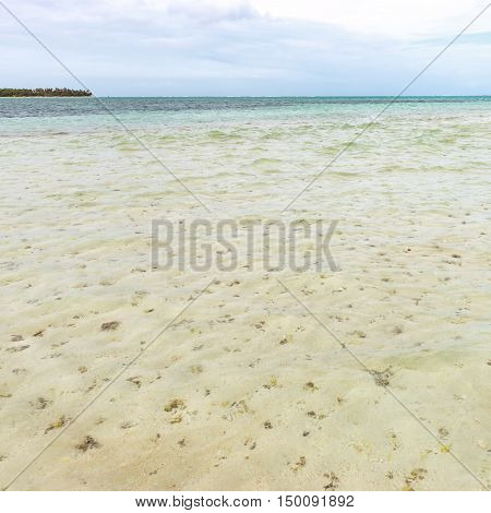 Nylon Pool in Tobago tourist attraction shallow depth of clear sea water covering coral and white sand square