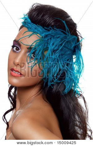 Tanned Beauty With A Feather.