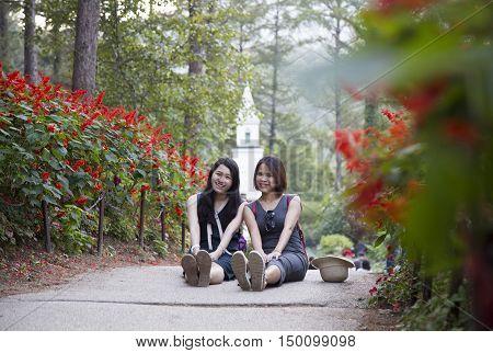 Gyeonggi-do, South Korea - Sep 24, 2016: Asian female tourists posing at The Garden of Morning Calm in Gyeonggi Province in time of fall season.