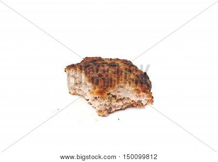 Bitten single prepared small hand made cutlet isolated over white background
